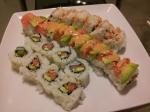Three different rolls, all with the same core ingredients of salmon and avocado.