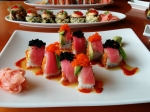 The Summer Dragon Roll: spicy tuna inside, avocado and tuna layered on the outside. Topped with tobiko and masago.