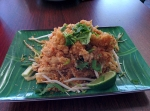 The popcorn crawfish pad thai, served with extra peanuts and lime on the side.