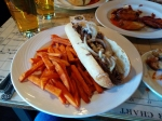 The D.C. Cheesesteak, coupled with a side of sweet potato fries