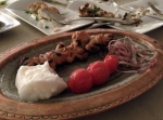 Shish Taouk - grilled chicken kebab with onions, tomatoes and Lebanese garlic sauce (toum)