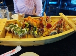 "The ""Roll Boat,"" which houses five sushi rolls selected from both the Chef's Special and the Chef's Signature menu."